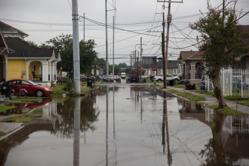Tropical Storm In Louisiana, Curbing Oil Production